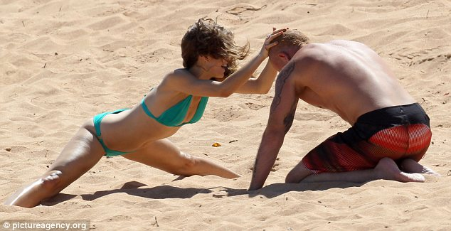 Gladiators Annalynne Challenges Her Man To A Wrestle In The Sand