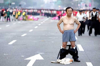 funny pics Chinese man protesting on the streets with pants down