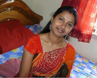 Yound girl kavya dressing in her bedroom.
