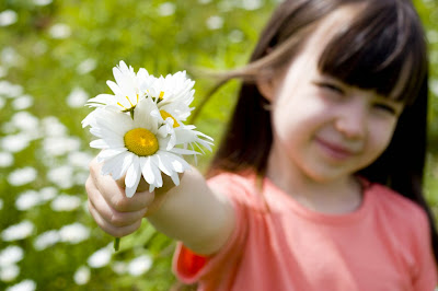 Innocent girl holding flowers photo