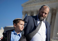 Ari Zivotofsky, right, stands with his nine-year-old son, Menachem, outside the Supreme Court in Washington, Monday, Nov. 7, 2011.