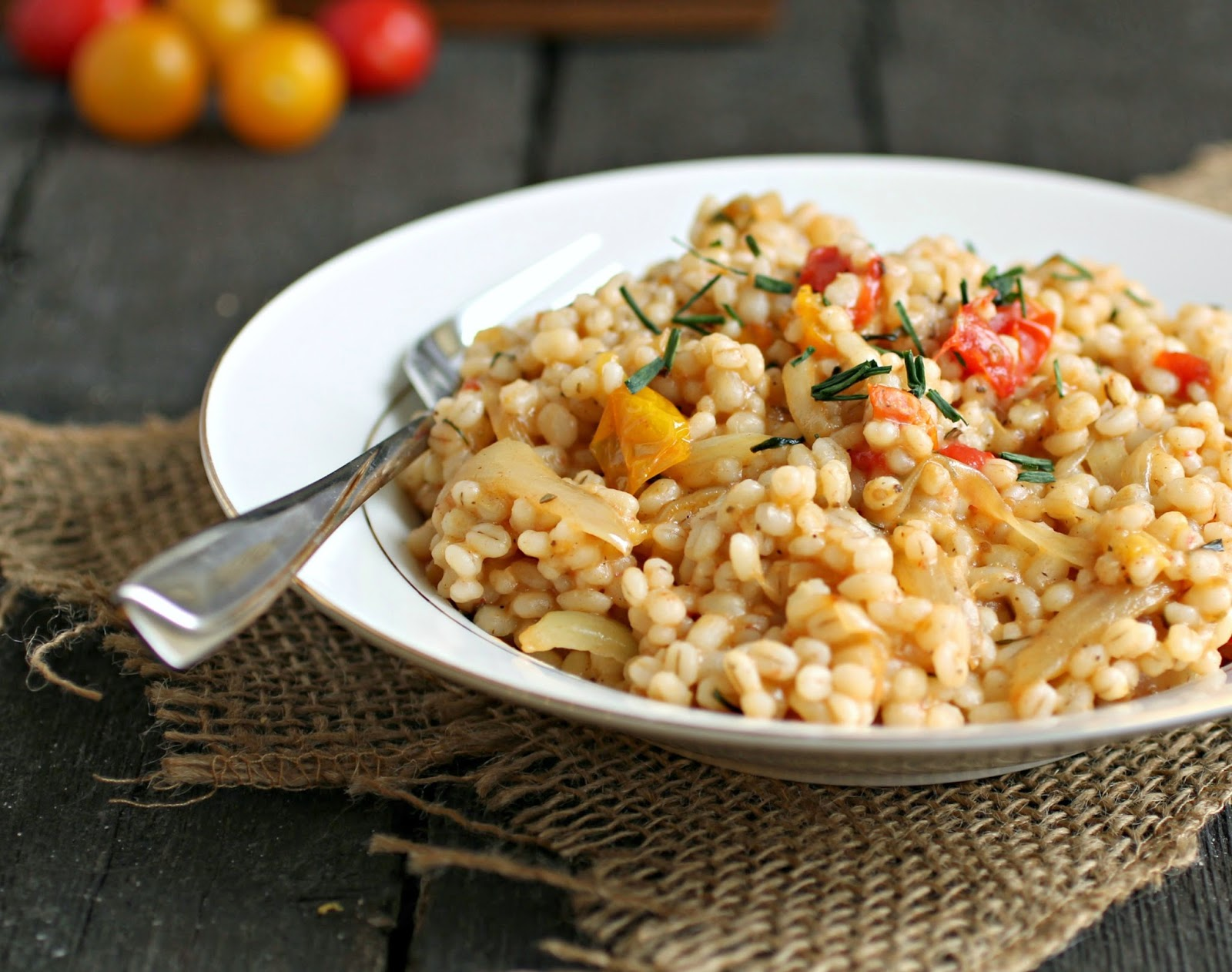 Recipe for fragrant, nutty barley as a wonderful side dish paired with sauteed onion and tomatoes.