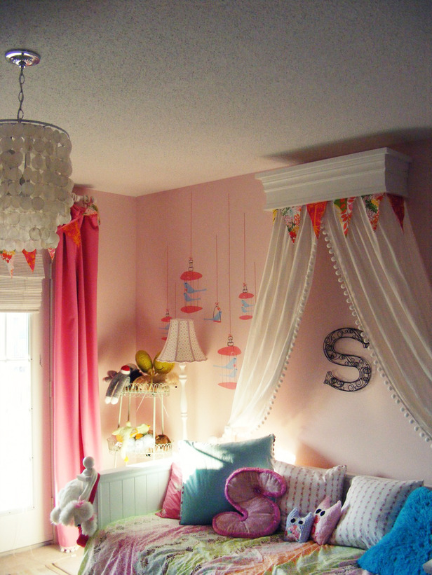 pink girls room with bed