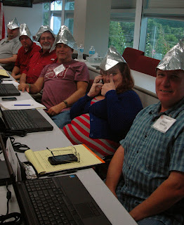 Participants jokingly don tin hats to ward off computer bugs.