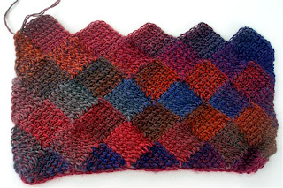 rainbow colored Motivated Heretic shawl, row 7 complete