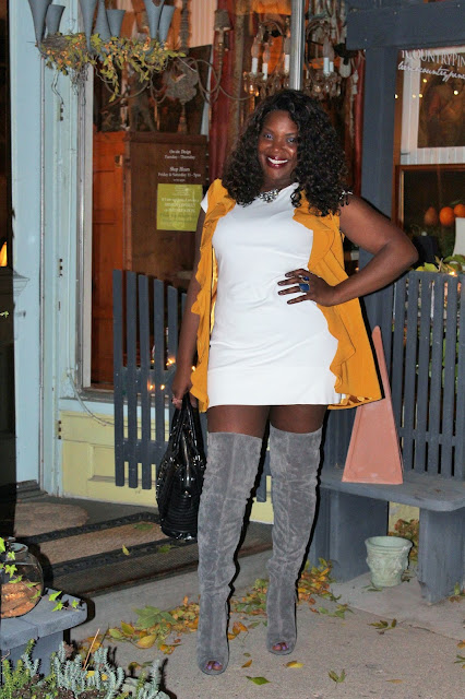 Wearing-gray-suede-over-the-knee-boots-with-fringe-detail-with-golden-ruffled-vest-and-white-mini-dress