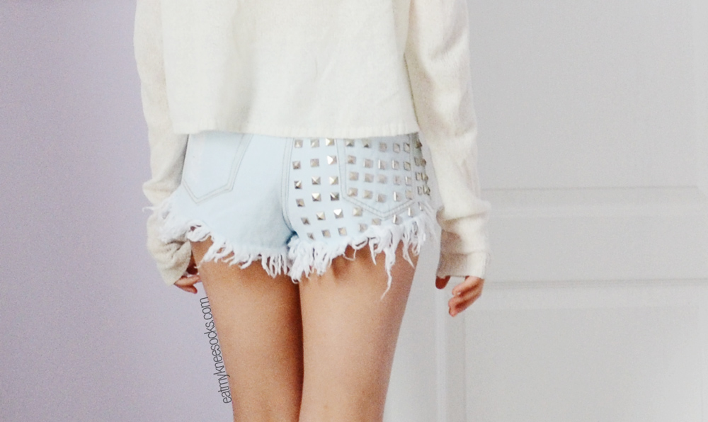 Back pocket and studded detailing on the high-quality destroyed denim shorts from JollyChic.