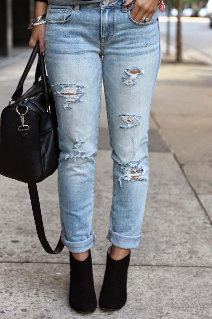 Light destroyed skinny jeans with ankle boots