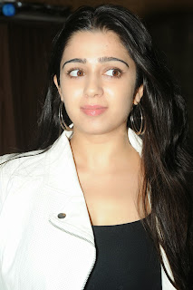 Actress Charmi Kaur Pictures in Jeans at One by Two Movie Celetes 20 Years Event 0045