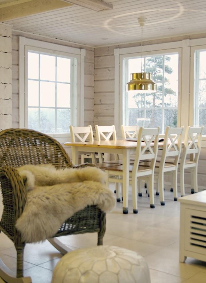 rattan chair, log home, log cabin living room