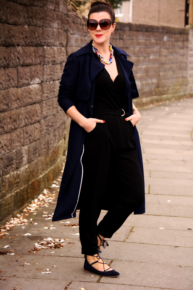 Navy trench with a black jumpsuit and pops of yellow for Boden jumpsuit
