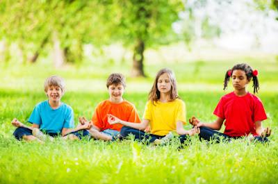 NAMC montessori student children doing yoga international day of peace activities