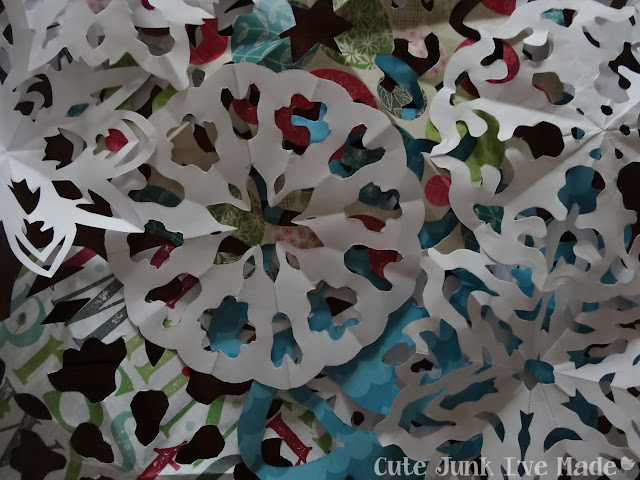 Paper Snowflake Curtain Tutorial - bajillions of snowflakes