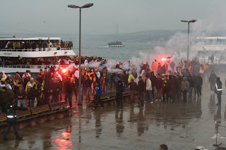 Fenerbahçe fans and boats leaving the jetty