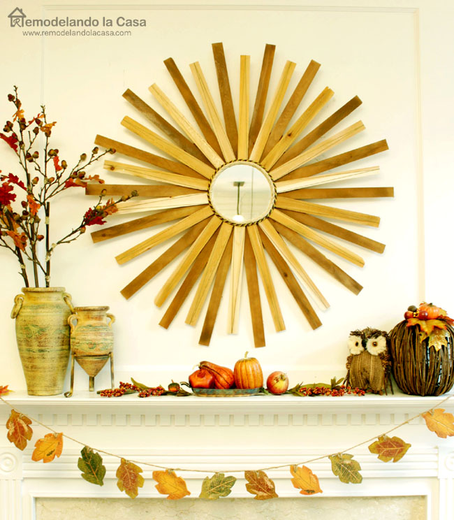 wood shims sunburst mirror and brown and earth tones mantel