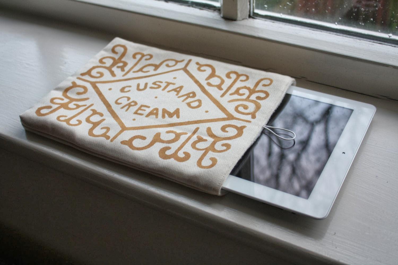 http://birdinborrowedfeathers.bigcartel.com/product/custard-cream-ipad-case-by-fayeray-designs
