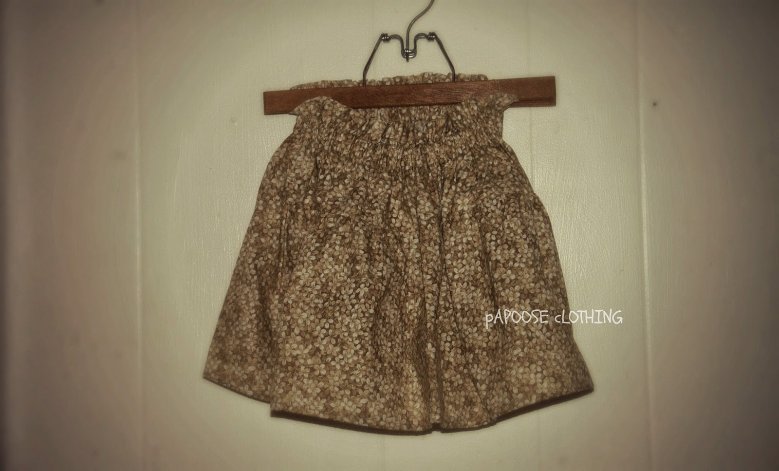 http://www.papooseclothing.com/store/p34/Caffe_Crema_Drop_Waist_Ruffle_Top_Skirt.html