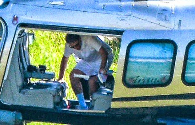 The 59-year-old were seen being delivered by helicopter to practices his favorite sport of tennis court on the island at Porto Cervo, Sardinia in Italy on Thursday, August 7, 2014.