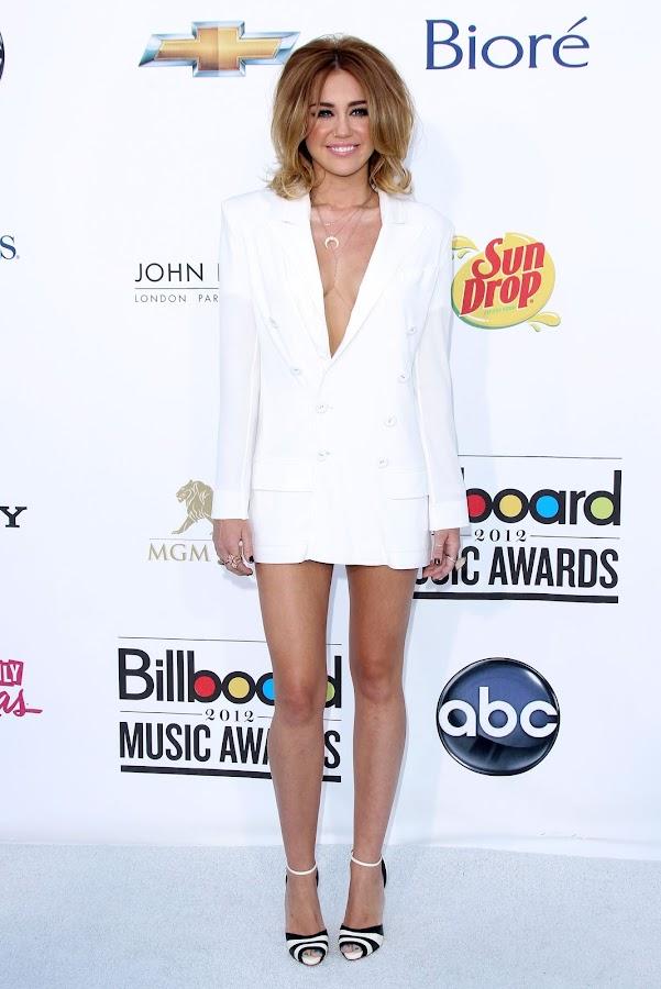 Miley Cyrus in short Jean Paul Gaultier jacket dress