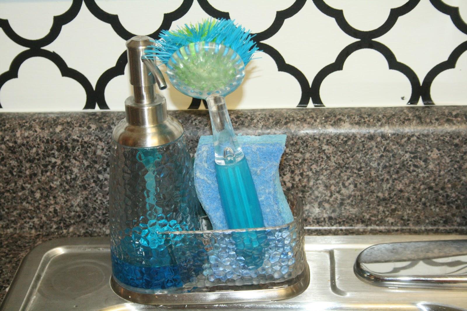 Dish soap dispenser with sponge holder