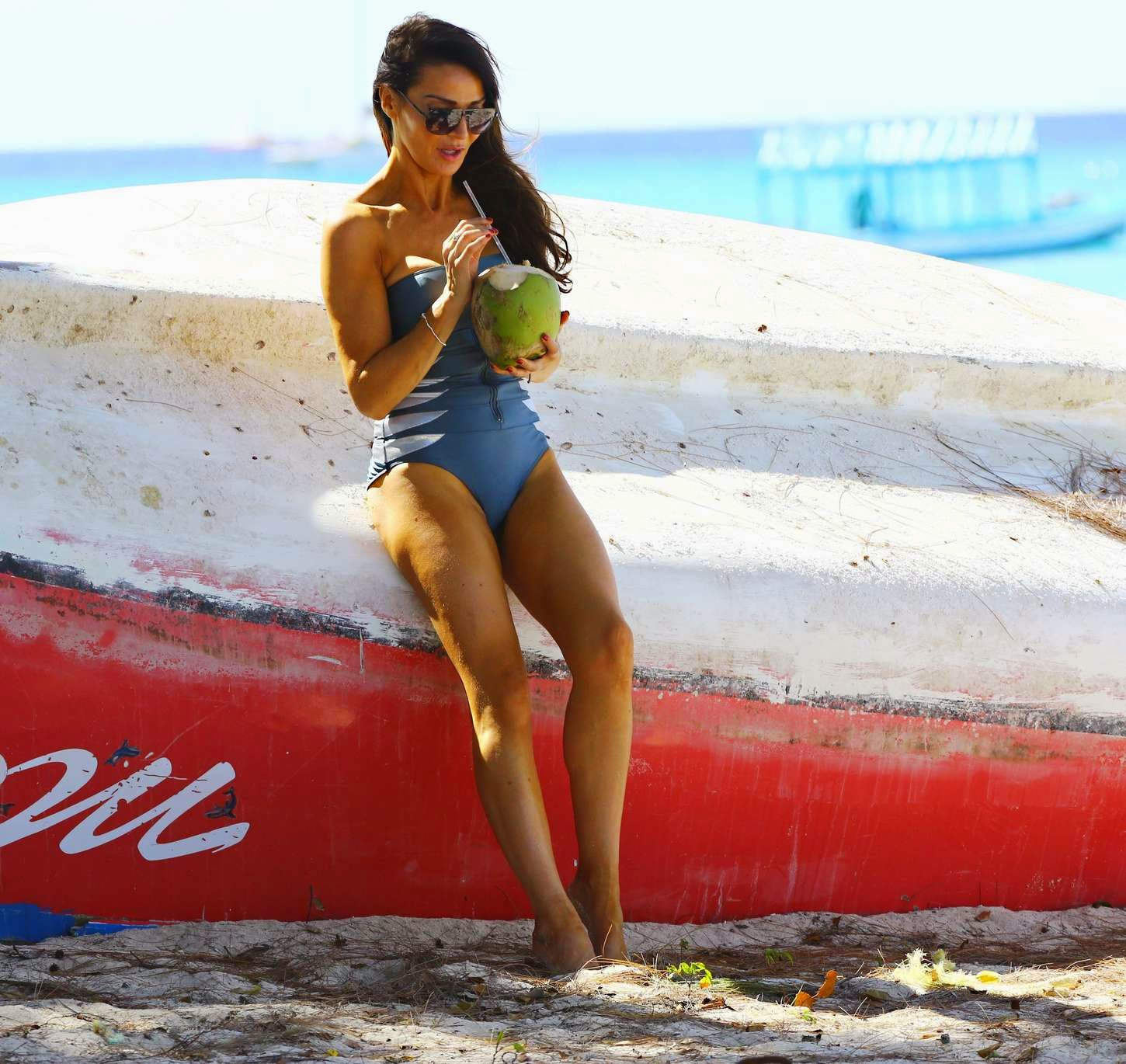 Lizzie Cundy shows off beach perfect body in a strapless swim suit