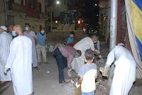 بالصور: قيادات الجماعة الإسلامية والإخوان يشاركون فى رفع القمامة من شوارع أسيوط علشان خاطر عيون مين !