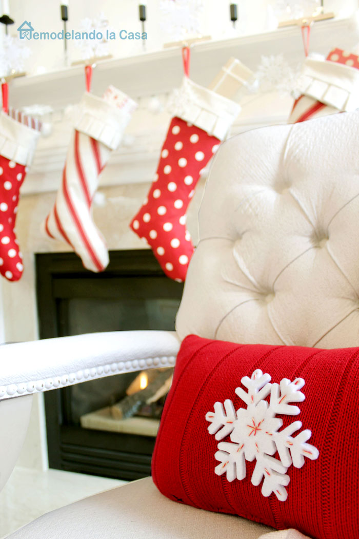 Christmas pillow with a red sweater and snow flake on it