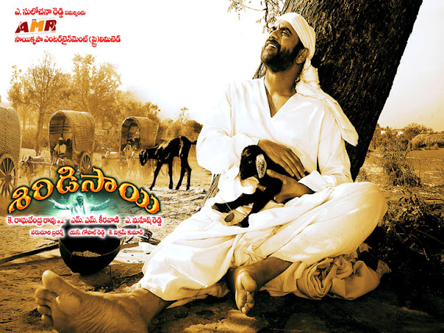 http://4.bp.blogspot.com/-Y2_qYP11kfs/UA-jJdNWcnI/AAAAAAAAXos/ovqvovYIR4o/s1600/Nagarjuna%27s+Shirdi+Sai+Movie+New+HQ+Wallpapers+5.jpg
