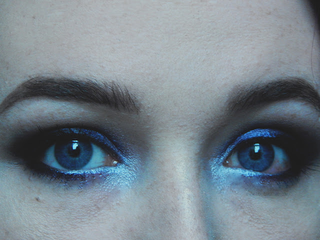 close up of dark eyeshadow on person with blue eyes