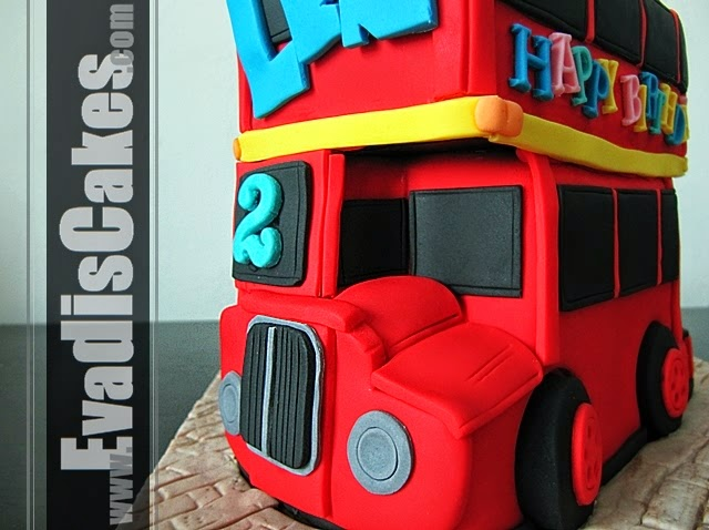 Closer view picture of London bus sculpture cake
