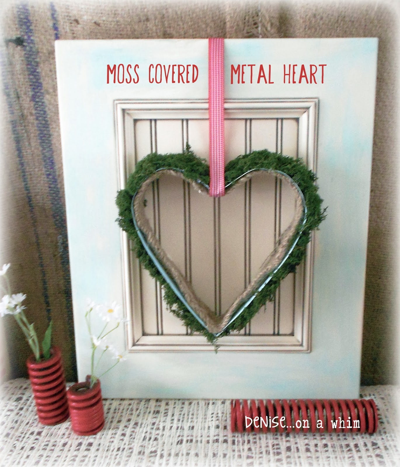 Pretty Valentine Wall Decor with a Cupboard Door and Baking Form via http://deniseonawhim.blogspot.com