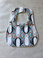 http://www.marymarthamama.com/crafty-cat/baby-bib-tutorial-with-free-printable-pattern/