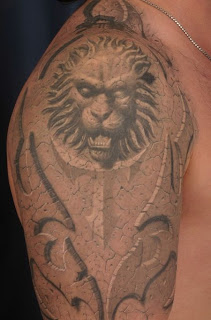 3D Style Lion Face Tattoo Design on Arms
