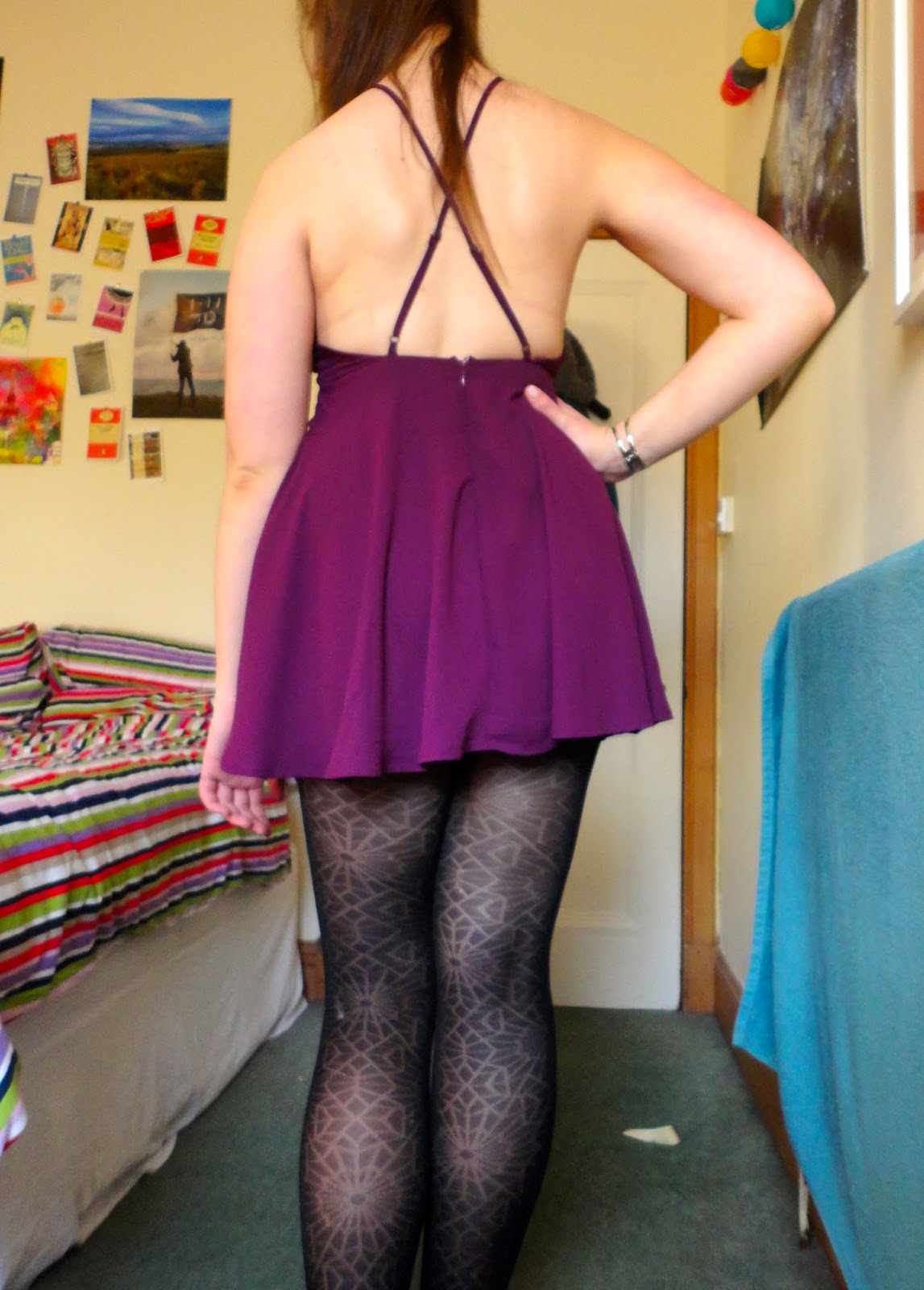 short purple backless dress, with thin crossed straps, black cobweb tights