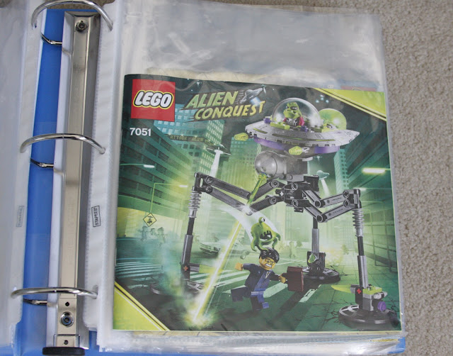 plastic sleeves in binder for lego instruction organization
