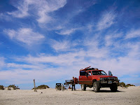 After 6 kilometers of slow paced driving across vast salt flats and hard-packed, corrugated sand roads, we finally reach Laguna Ojo de Liebre.  We idle up to the kiosk and pay the security guard 65 pesos ($5 US dollars) for our entrance fee, as Shanno...