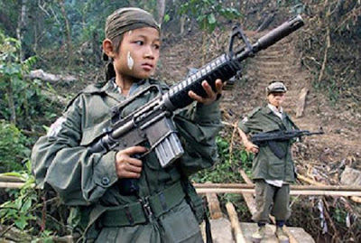 child soldier asia m16 assault rifle