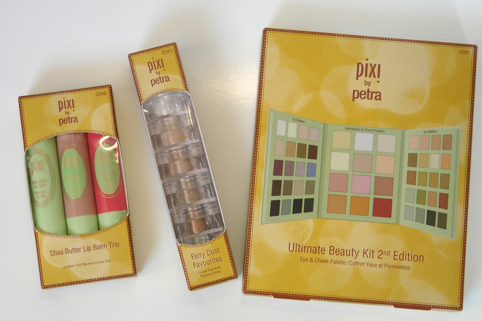 PIXI Christmas collection, beauty, blusher, eye shadows, highlighter, lip balm, make up, palette, PIXI, review, beauty blogger, UK blog, PIXI Ultimate Beauty Kit 2nd Edition, PIXI Fairy Dust Favourites - Light Catchers, PIXI Shea Butter Lip Balm Trio