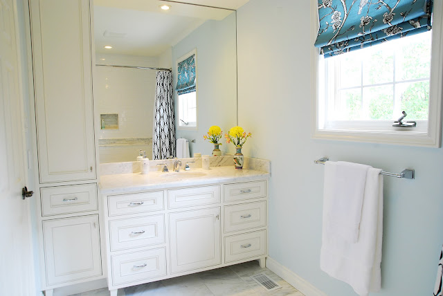the showstopper in this bathroom is definitely the new custom vanity this being a guest bathroom it wasnt necessary to have a double sink basic bathroom strip