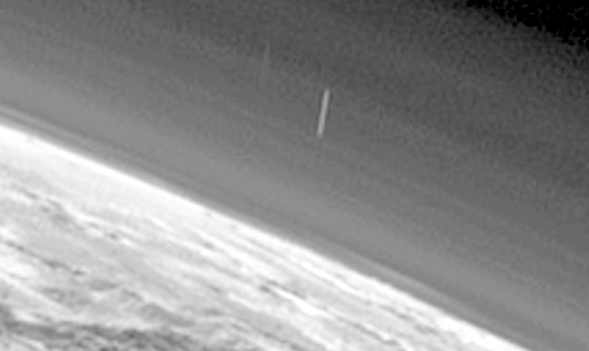 Huge Cigar UFO Caught Above Pluto 2015, UFO Sightings