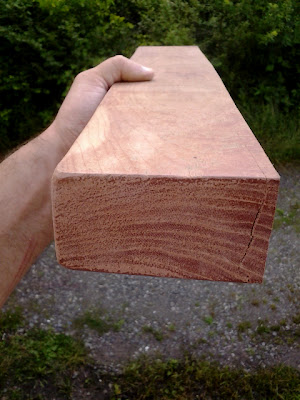 cross cut from an aged hardwood timber, possibly Black Walnut