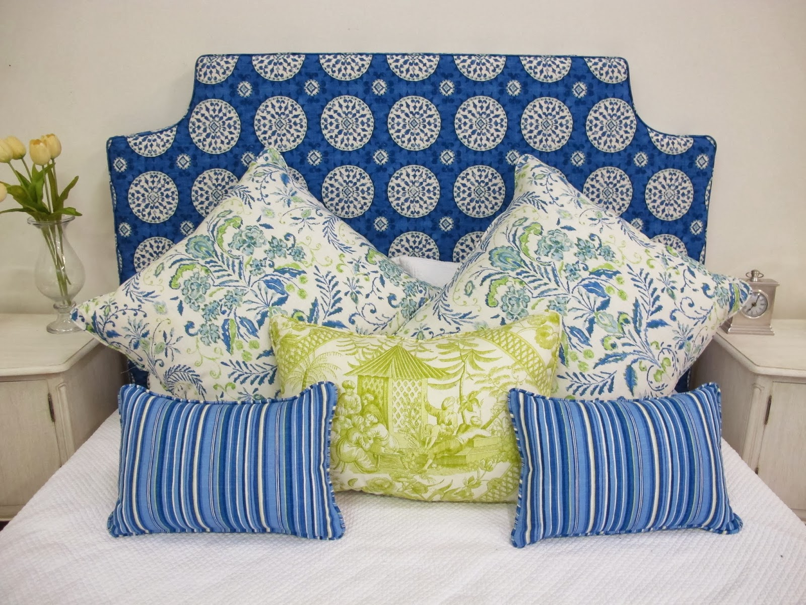 Patterned fabric used on padded bedhead made by Bedhead design, removable loose cover.