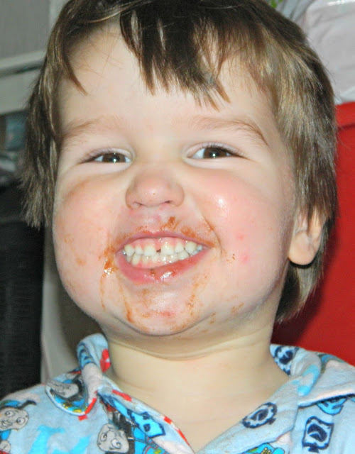 Small boy toddler chocolate face