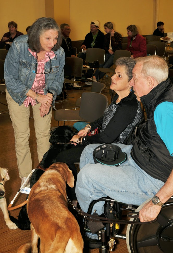 a puppy raiser speaks with Marlaina Lieberg and her husband.