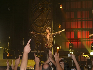 Mike jagger entertaining thrilled fans at a rock concert