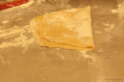 folding over the flour, dough