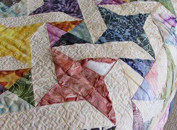 damaged scrapy bed quilt
