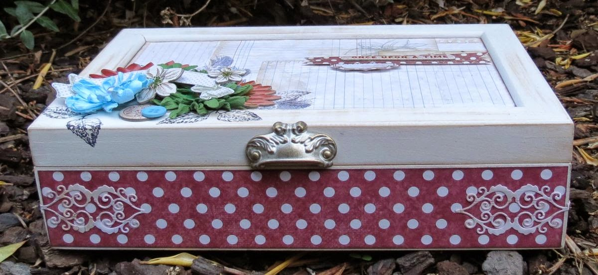 An altered box by Megan Gourlay using BoBunny new Floral Stamps