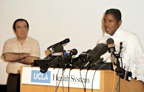 Dr. Tohme with Jermaine Jackson announcing Michael's death