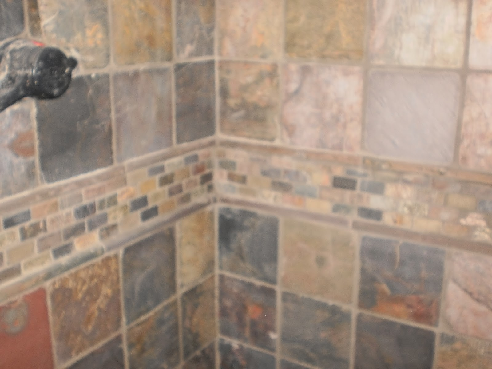 Installing natural slate tile heres how to do it ask tile shower wall slate dailygadgetfo Gallery
